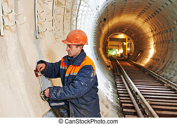 tunnel worker at underground construction site