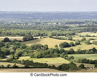 tunning vibrant landscape image of English countryside on lovely Summer afternoon overlooking rolling hills and country villages