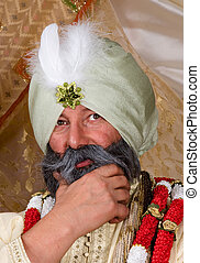 Turban - Close-up of a man wearing a traditional turban