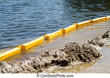 Turbidity curtain used at this construction site along the inter-coastal waterway to trap silt and sediment and keep it from polluting the water during excavations.