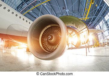 Turbine engine blades during maintenance, the plane in the hangar.