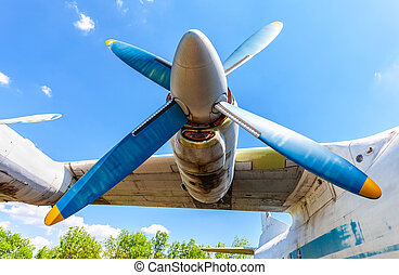 Turbine of old soviet turboprop aircraft against the blue...