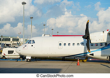 Turboprop aircraft with propellers in an airport - Turboprop...