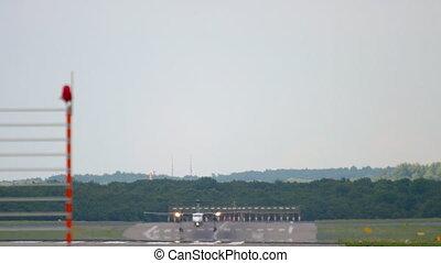 Turboprop airplane approaching and landing in Dusseldorf Airport