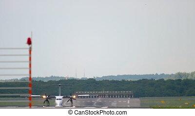 Turboprop airplane braking after landing