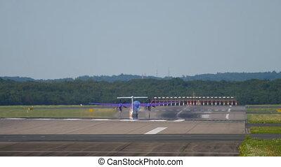 Turboprop airplane departure from Dusseldorf Airport,...