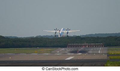 Turboprop airplane departure from Dusseldorf Airport, Germany