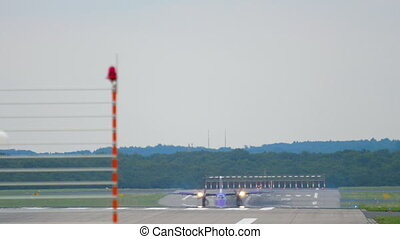 Turboprop airplane taxiing after landing - Turboprop...