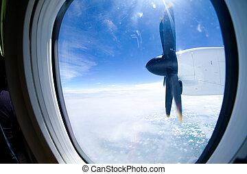 turboprop plane propeller seen through the window during...