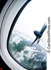 Turboprop plane propeller seen through the window during...