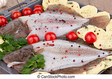 Turbot Fish Ready For Baking - Tray with turbot fish and ...