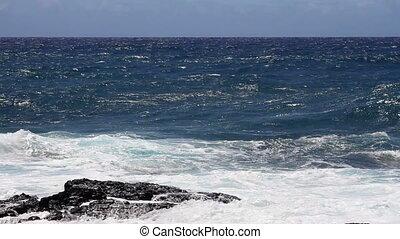 Turbulent Ocean - Ocean waves breaking off a rocky shore