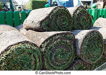turf is laid by gardener