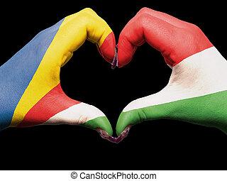 turista, hecho, gesto, por, bandera de seychelles, coloreado, manos, actuación, símbolo, de, corazón, y, amor