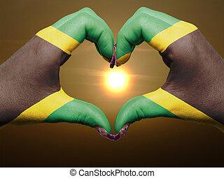 turista, perú, hecho, por, bandera jamaica, coloreado, manos, actuación, símbolo, de, corazón, y, amor, durante, salida del sol
