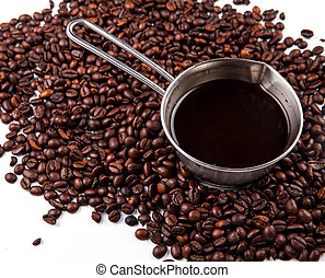 Turk with coffee beans isolated on white background