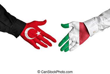 Turkey and Italy leaders handshake