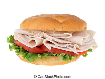 Turkey breast sandwich on a bun with lettuce and tomato isolated on white
