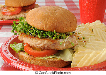 A delicious turkey burger with clover, radish and alfalfa sprouts