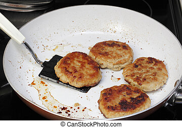 Turkey Burgers Finished Cooking in a Pan