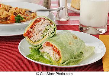 Turkey club sandwich wrapped in a spinach tortilla