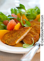 Turkey escalope - Breaded turkey escalope with citrus salad