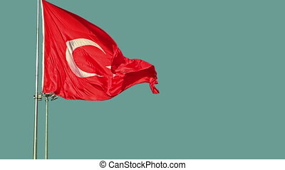 Turkey flag waving in the wind against the blue sky on...