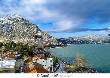 Turkey, Isparta province, beautiful Egirdir lake and Needle mountain with mosque in winter