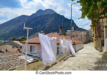 Turkey, Isparta province, Egirdir street with traditional old houses on the background of the Needle mountain in summer
