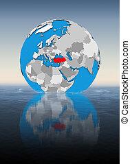 Turkey on globe in water