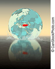 Turkey on globe splashing in water