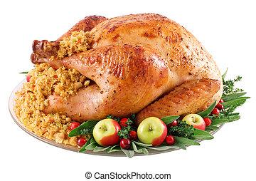 Turkey - Roast turkey with cornbread stuffing on a platter. ...