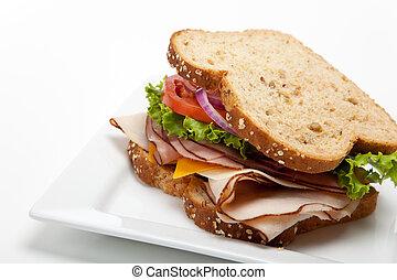 Turkey sandwich on white background - A turkey sandwich on...