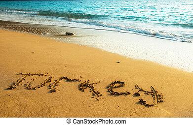 Turkey written on sandy beach