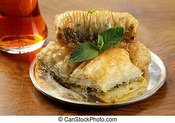 Turkish arabic dessert - baklava with honey and walnut, pistachios nuts