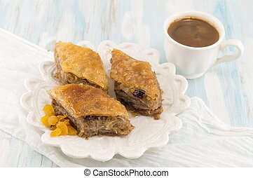 Turkish baklava dessert and coffee on a plate