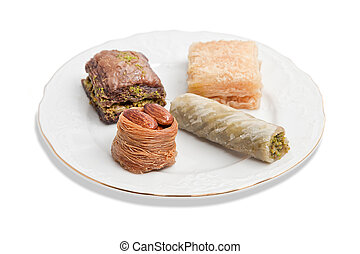Plate with various turkish baklava isolated over white background