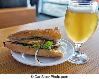 Fish sandwich street food Glass of beer