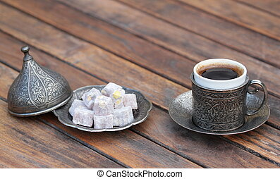 Turkish coffee and turkish delight with old traditional embossed metal cup