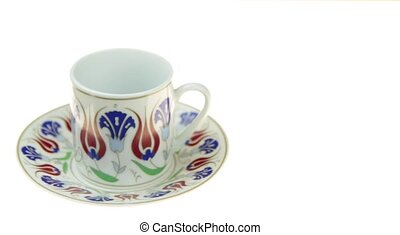 Turkish coffee with traditional ottomans motif cup on white...