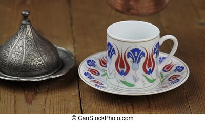 Turkish coffee with traditional ottomans motif cup and...