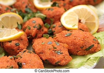 Turkish cuisine. Bulgur and lentil vegetarian dumplings ( Mercimekli Kofte ) close up image