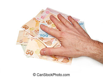 A hand holding a mixture of Turkish Lira Currency, on a white background.