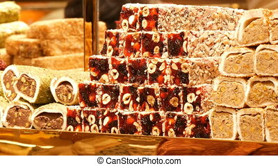 Turkish delight for dessert. Lokum dish on sale in Istanbul food store. Traditional sweet locum. Lot of different oriental sweets, Turkish delight with various fillings on the store counter