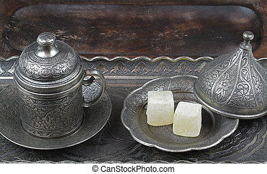 Turkish delight in traditional Ottoman style carved patterned metal plate and coffee cup