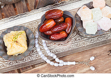 Turkish delights with tasbih on silver oriental tray, top ...