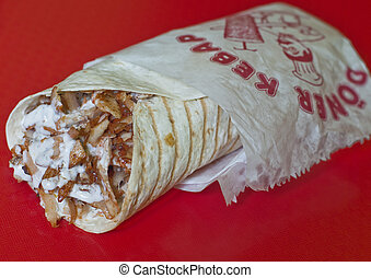 Traditional turkish doner kebab in lavash bread served with youghurt sauce