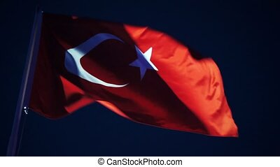 Turkish flag at the windy night sky. - Turkish flag at the...