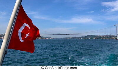 Turkish flag waving on the stern of an Istanbul Ship is Floating