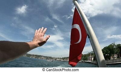 Turkish flag waving on the stern of an Istanbul Ship is Floating, Tukriye Bye bye